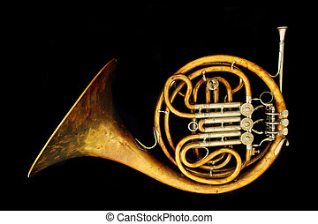 old french horn isolated on the black background