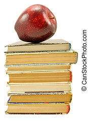 books with red apple over white