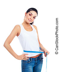 woman measuring waist - happy young woman measuring her...