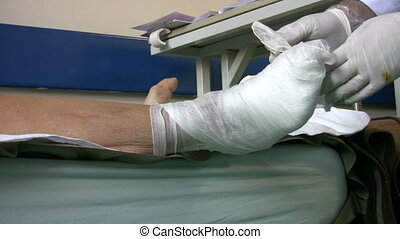 Doctor bandaging diabetic foot