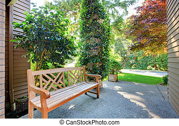 Front entrance bench with summer landscape