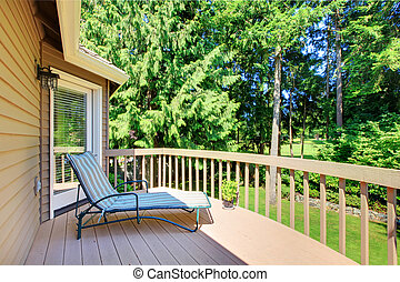 Balcony with summer back yard with pine trees
