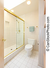 Bathroom with white tiles and glass shower