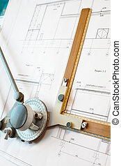 Old-fashioned dawing board with white project blueprint
