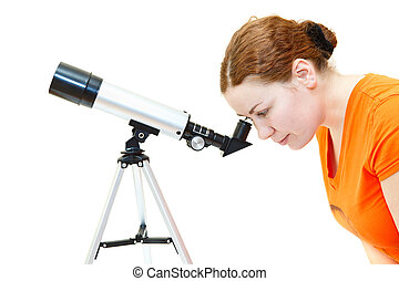 Young woman in orange t-shirt looking through telescope on...