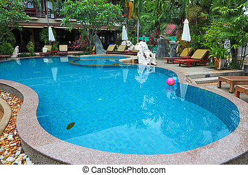 Two inflatable balls in pool with the transparent water,...