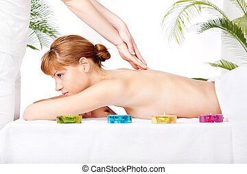 Back massage - Pretty woman getting a back massage in spa...
