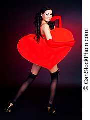 girl with a heart - sexy young woman with a big heart in her...