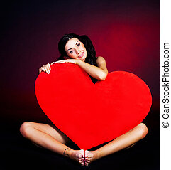 girl with a heart - sexy young woman with sitting on the...