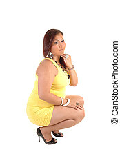Full figured girl crouching. - A pretty full figured young...
