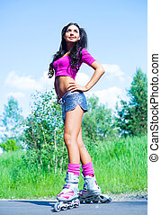 woman on roller skates - happy young brunette woman on...