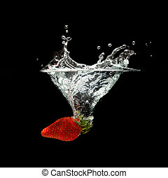 strawberry splashing in water over black background