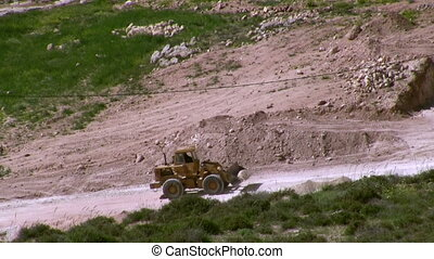 bulldozer open new road in vally