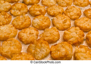 Tater Tots (Horizontal) - Multiple Crispy Tater Tots in Rows...