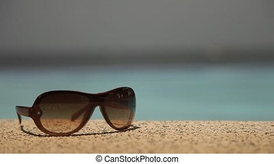 Sunglasses at Pool and Ocean