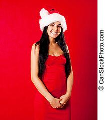 Santa - beautiful brunette girl wearing a Santas hat against...