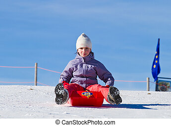 A girl sliding in the snow