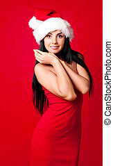 Santa - beautiful brunette girl wearing a Santa's hat...