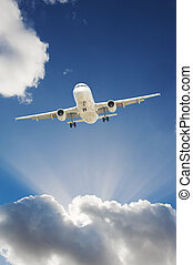 Airplane in the sky - Large passenger airplane flying in the...