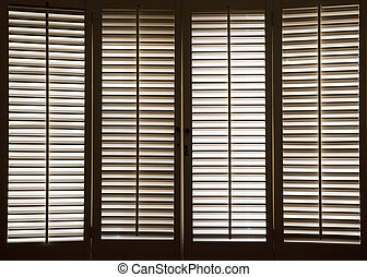 Wooden Window Shutters - Wooden shutters in front of bright,...