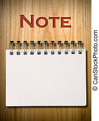 Note Book on wood wall