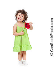 little girl with African daisy flower in studio isolated