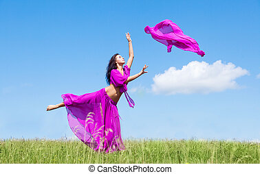 dancing woman - happy dancing young woman outdoor on a...