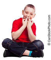 child - ten year old boy picking his nose , isolated against...