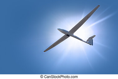 sailflying - A glider shot from below against a blue sky and...
