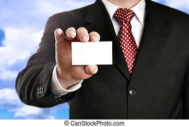 Businessman showing his business card, focus on fingers and...