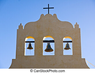 Three bells and a cross - Churchtower in northern Argentina...