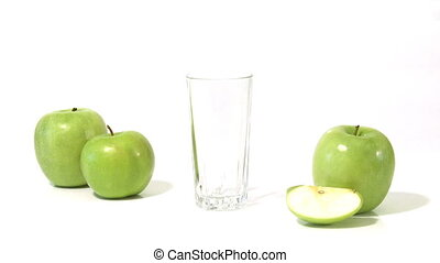 apples with juice - Pouring apple juice into a glass