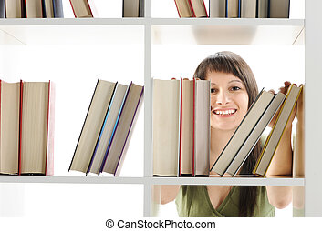 young Woman looking for a book at the library - young Woman...