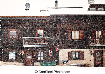 Snowing in front of tradition house facade