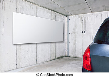 Blank white advertisement board on the wall in public parking area space