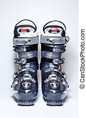 Modern professional ski boots on white background