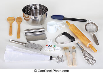 Baking Utensils - Assorted baking utensils on a white...