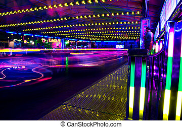 bumper cars in motion - View of a amusement park bumper cars...