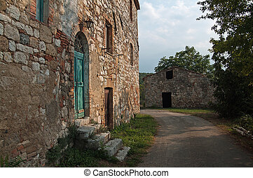 old farmhouse - facade of an old farmhouse near Badia a...