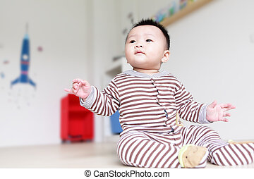 Cute Baby Look Up forward with home background, Baby is a...