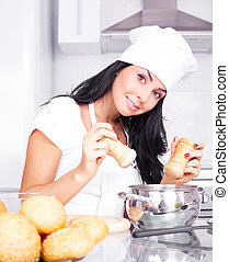 woman cooking - beautiful brunette woman cooking soup in the...