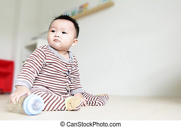 Cute Baby look left and take his feeding bottle with home...