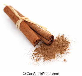 Cinnamon sticks and meal close up on white