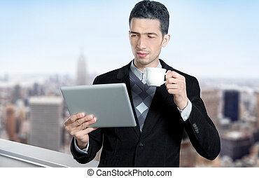 Young Businessman Using A Tablet Computer - Young...