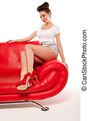 Pert Pinup Girl On Red Sofa - Beautiful pert leggy retro...