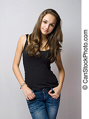Beautiful young jeans model - Half length portrait of...