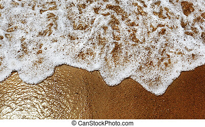 Water rolling onto a sandy beach.