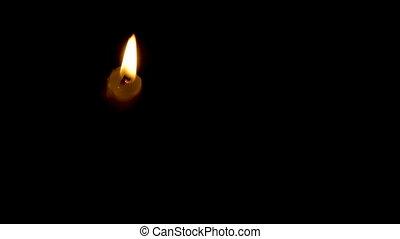 Timelapse burning white candle