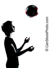 one young teenager boy  girl silhouette tossing soccer football