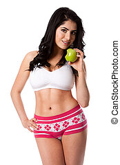 Eat an apple to stay fit - Beautiful happy young woman fit...